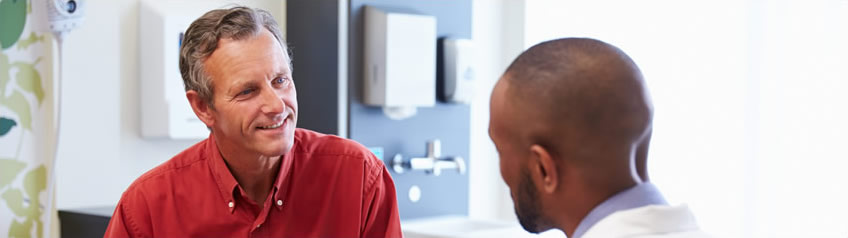 A male patient talking to a doctor